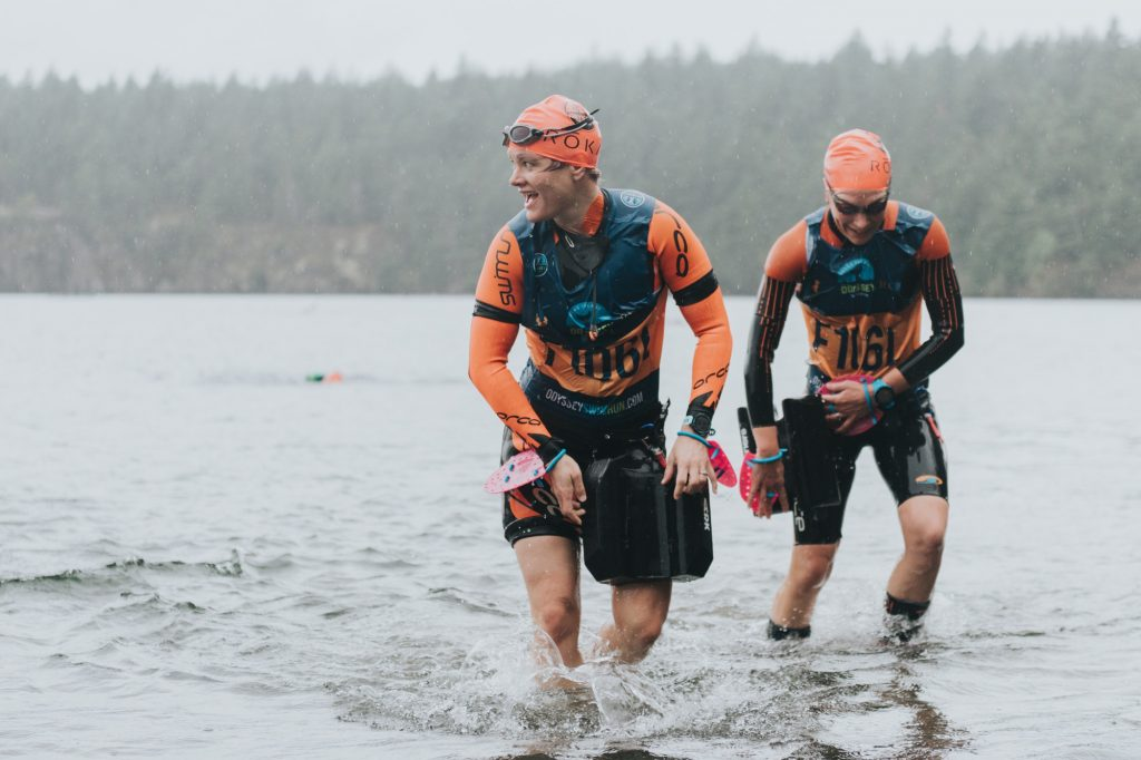 Two female swimrunners exiting the water