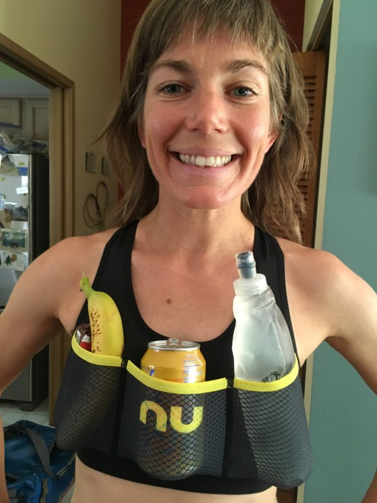 Annie wearing the Nu Lapa bra with banana, candy bar, soda, and water flask in the pockets