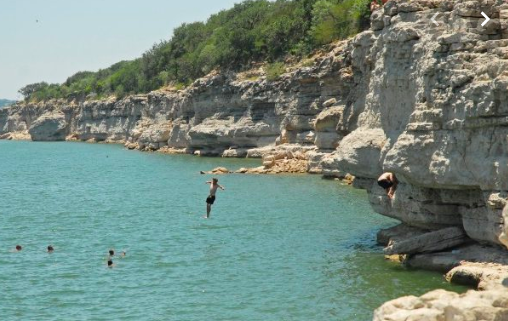 People cliff jumping at Pace Bend Park, location of Odyssey Swimrun Austin