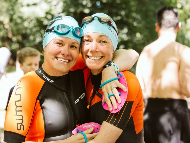 About Swimrun Labs: Co-founders, Brooke and Annie, hugging each other after a swimrun race