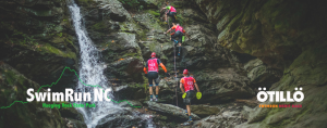 Swimrunners climbing up waterfall